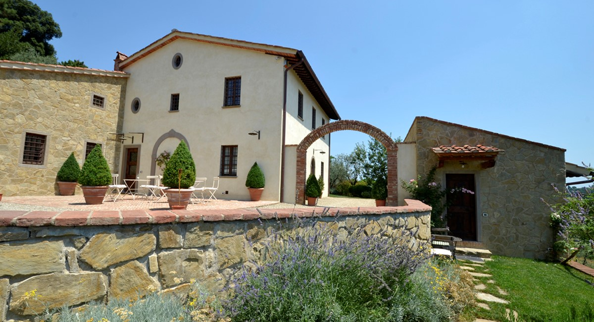 house with arch and limonaia cottage.jpg