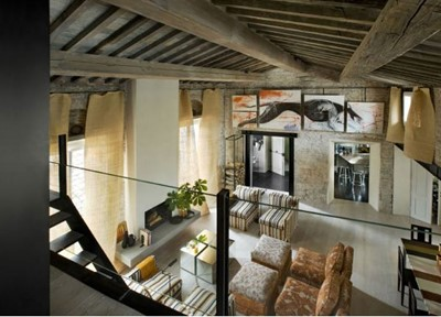 living rom with beams florence luxury.jpg